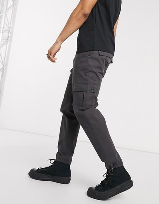 Asos DESIGN tapered cargo trousers with toggles in washed black