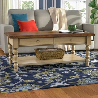 Three Posts Courtdale Solid Wood Coffee Table with Storage Color: Almond / Wheat