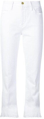 Frame Fringed-Hem Fitted Jeans