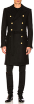 Balmain Belted Trench Coat in Black.