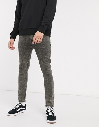 ASOS DESIGN cropped super skinny jean in black acid wash