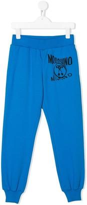 MOSCHINO BAMBINO TEEN logo printed track pants