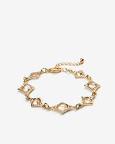White House Black Market Goldtone Diamond Shapes Bracelet with Crystals from Swarovski