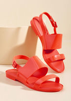 Classy Sandal Anytime the dancing rays and whispering tide lure you outside, you'll want these neon coral sandals from Melissa Shoes affixed to your feet! Not only are these strappy slingbacks the perfect pop of color for your outfit, their soft rubber construction is