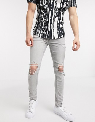 Topman organic spray on jeans with blowout rips in grey