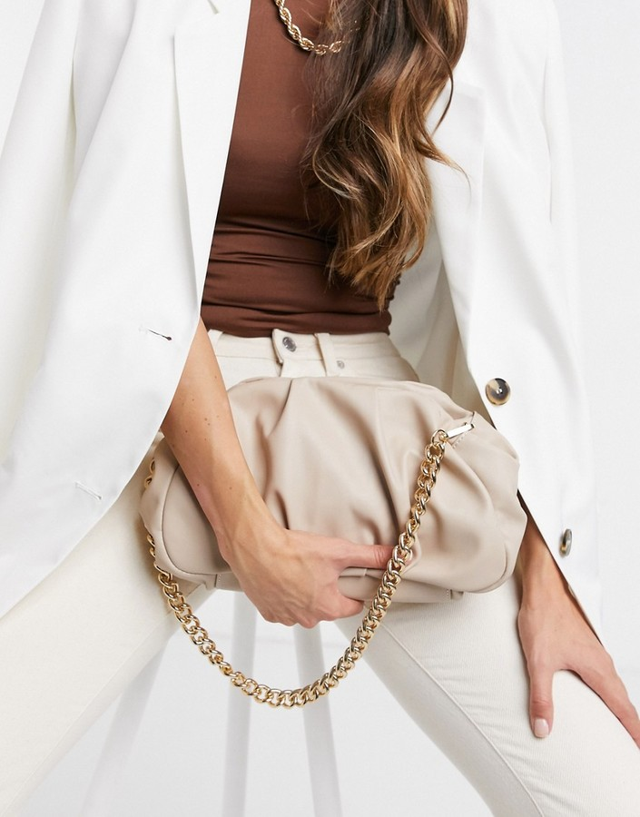 ASOS DESIGN oversized ruched clutch in beige with detachable shoulder chain