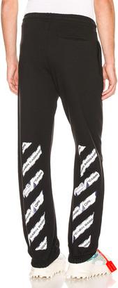 Off-White Airport Tape Slim Sweatpant in Black & Multi   FWRD