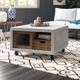 Desantiago Wheel Coffee Table with Storage Brayden Studio Color: Black
