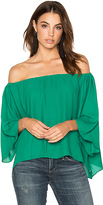 Krisa Off Shoulder Drape Top in Green. - size XS (also in )