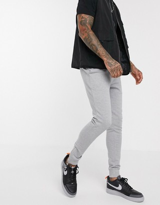 ASOS DESIGN organic skinny sweatpants in gray marl with silver zip cuffs