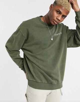 ASOS DESIGN oversized sweatshirt in washed khaki with print