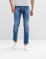 Tommy Hilfiger Jeans In Slim Fit Mid Wash