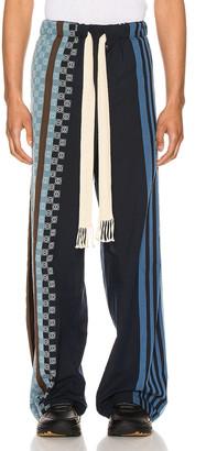 Loewe Stripe Anagram Trousers in Navy Blue & Multi   FWRD