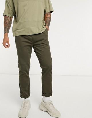 ASOS DESIGN slim chinos with elastic waist in dark khaki