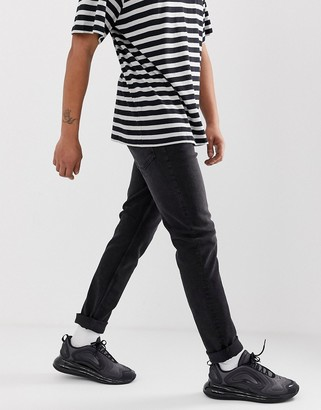 Cheap Monday sonic slim tapered jeans in black mode