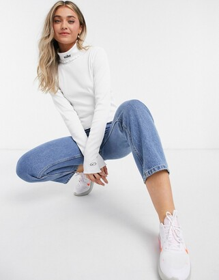 Nike ribbed high neck long sleeve crop top in white