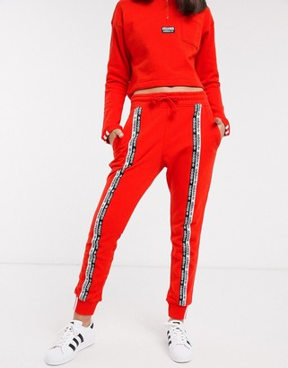 adidas RYV taping joggers in red