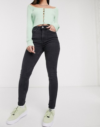 Pieces Delly high waisted ripped skinny jeans in washed black