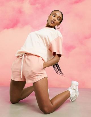 Nike mini metallic swoosh shorts in coral