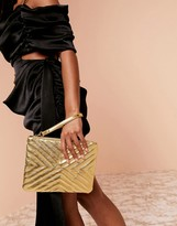Asos Design DESIGN Luxe quilted zip top clutch bag