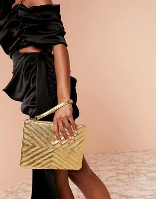 Asos Design DESIGN Luxe quilted zip top clutch bag-Gold