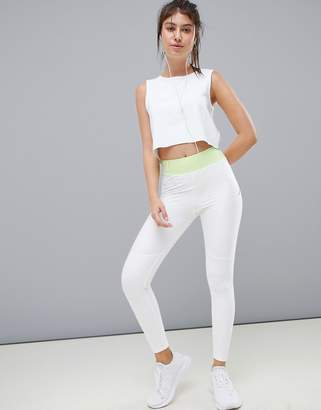 Asos 4505 4505 training legging with bonded waistband and laser cut technology-White