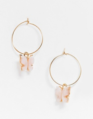 ASOS DESIGN hoop earrings with pink butterfly charm in gold tone