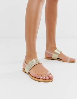 Park Lane toe loop sandals in gold-Beige