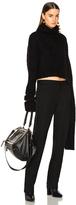 Ann Demeulemeester Asymmetric Hem Turtleneck Sweater in Black.