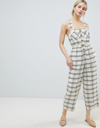 Asos Design DESIGN Jumpsuit With Elasticated Waist And Button Detail In Check-Cream