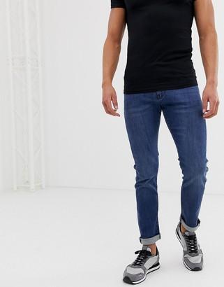 Armani Exchange J13 stretch slim fit jeans in mid blue wash