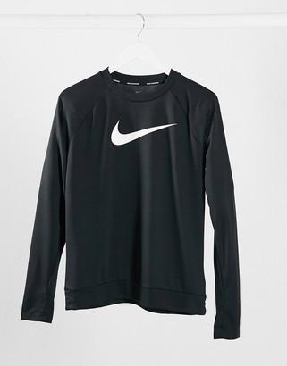 Nike Running swoosh logo crew neck long sleeve top in black