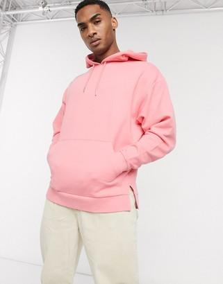 ASOS DESIGN oversized hoodie with split hem in pink