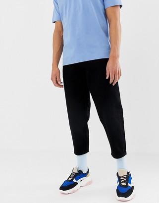 ASOS tapered cropped jeans in 14 oz black denim