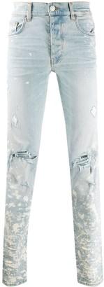 Amiri ripped mid-rise skinny jeans
