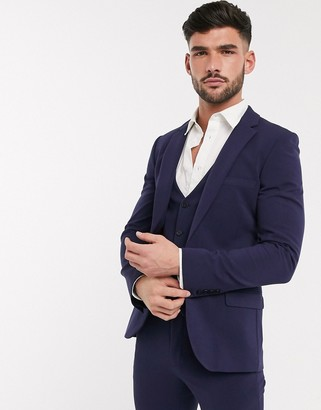 ASOS DESIGN super skinny suit jacket in four way stretch in navy