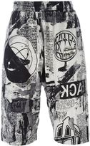 Kokon To Zai newspaper print shorts - men - Cotton - XS