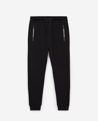 The Kooples Slim black joggers w/zipped pockets & badge