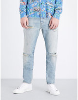 Saint Laurent Distressed Slim-fit Tapered Jeans