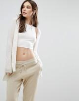 Subtle Luxury Cashmere Hi Low V-Neck Cardigan In White