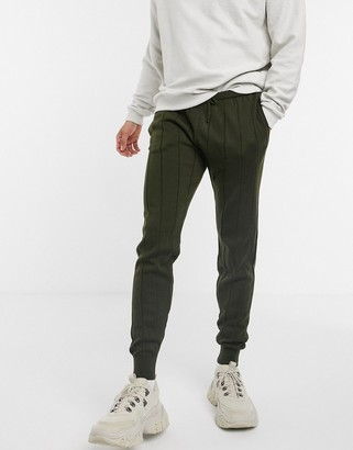 ASOS DESIGN knitted wide rib track pants in khaki