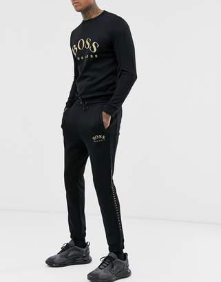 Boss Athleisure BOSS Athleisure gold logo cuffed joggers in black