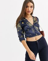 Neon Rose tea blouse with plunge button front in celestial print