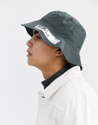 Asos DESIGN wide brim bucket hat in gray nylon with branded patch