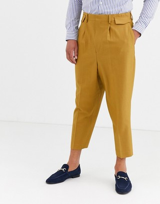 Asos Design DESIGN pleated drop crotch tapered smart trousers with pocket flaps in camel-Beige