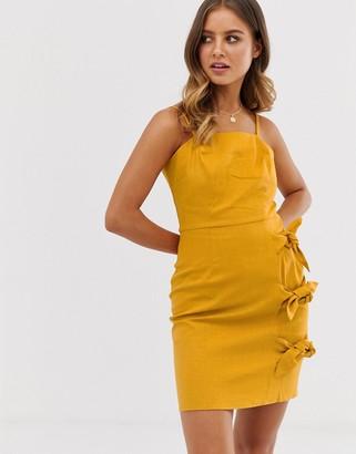 Asos Design DESIGN cami mini sundress with bow tied skirt-Yellow