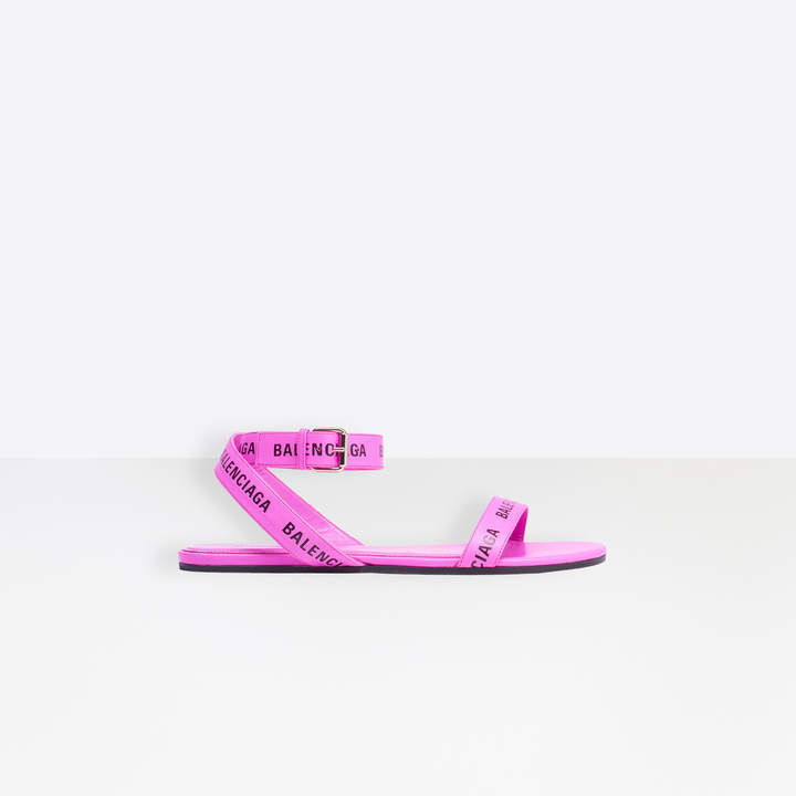 Balenciaga Allover Logo Round Flat Sandal in pink and black embossed smooth leather