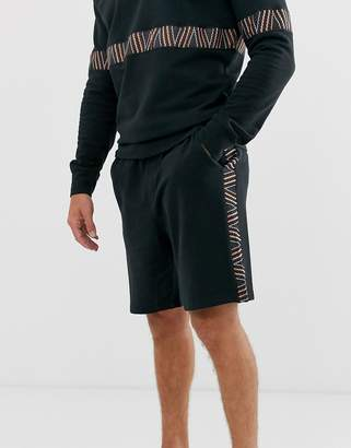 Jack and Jones Intelligence CO-ORD jersey short with taping in black