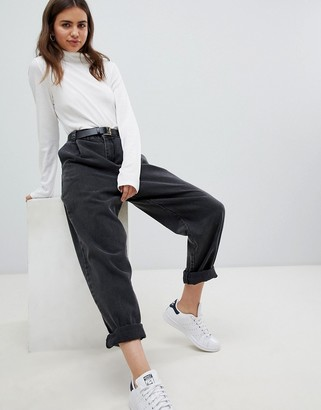 ASOS DESIGN tapered boyfriend jeans with curved seams and belt in washed black