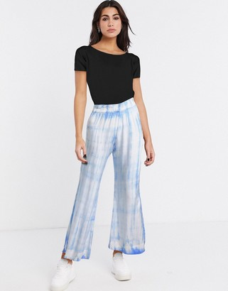 Weekday Shear tie-dye flared trousers in pastel blue